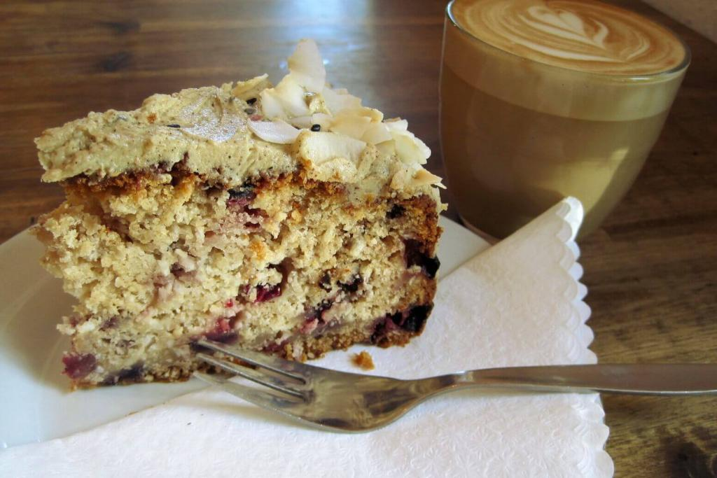 Coconut berry cake and a cappuccino